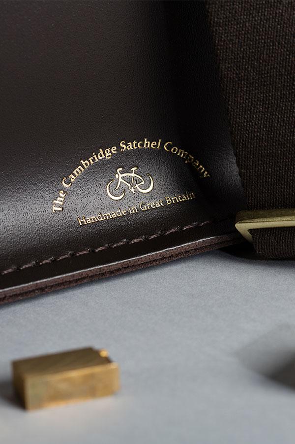 The Cambridge Satchel Company hot foil embossed logo beside letterpress stamps