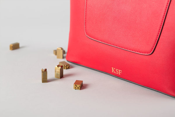 Embossed leather handbag with initials