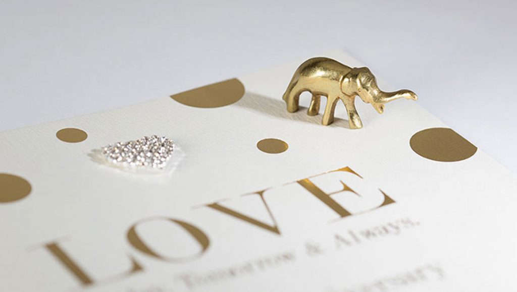 hot foil printed gold card with small gold elephant
