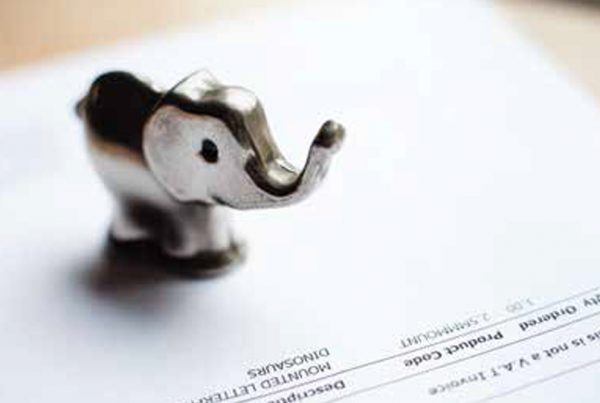 small gold elephant standing on product invoice